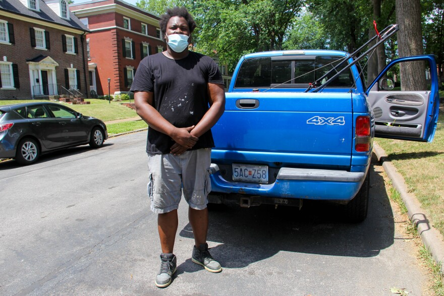 Jermell Hassan Williams standing at his pickup truck in his neighborhood Visitation Park on June 19, 2020.