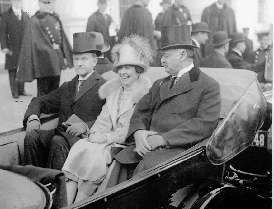 Calvin Coolidge (left) wears wing collar and muted top hat en route to take oath on Inauguration Day, March 4, 1925.
