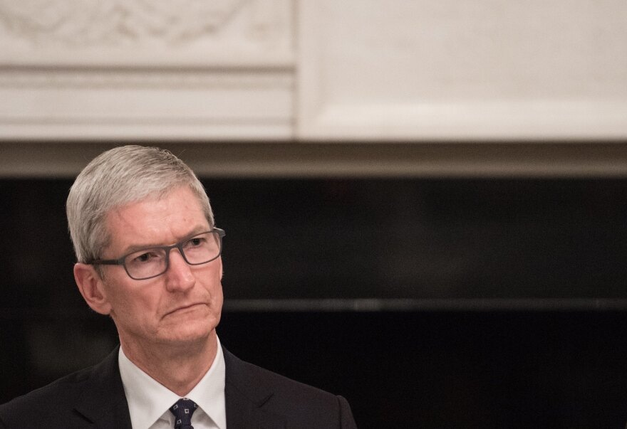 Apple CEO Tim Cook listens to a speaker during an American Technology Council roundtable at the White House on June 19. Cook is speaking out against the decision to end the DACA program, which affects more than 250 Apple employees.
