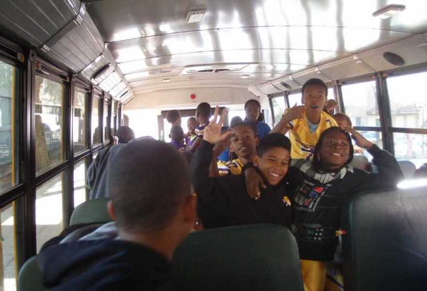 Kids on the Mo Better Jaguars football team board a bus in Brownsville, Brooklyn to go to a game in September 2014.