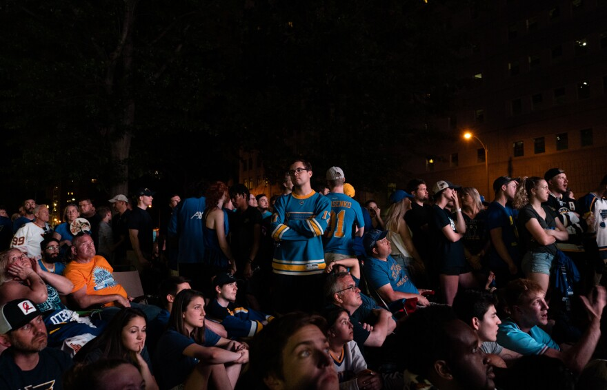St. Louis Blues fans cope with a Game 6 loss to the Boston Bruins at the watch party downtown on Sunday. June 9, 2019
