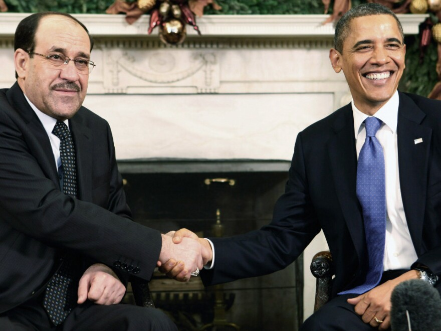Iraqi Prime Minister Nouri al-Maliki shook hands with President Obama in the Oval Office at the White House earlier today (Dec. 12, 2011).