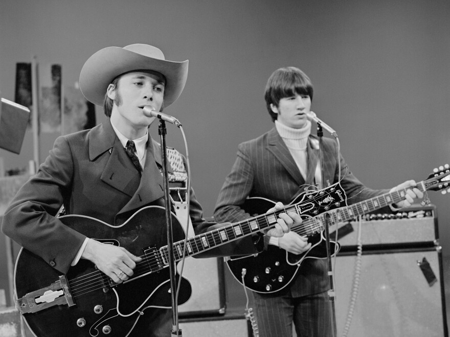 Stephen Stills (left) performs with Buffalo Springfield on <em>The Smothers Brothers Comedy Hour</em> in 1967.