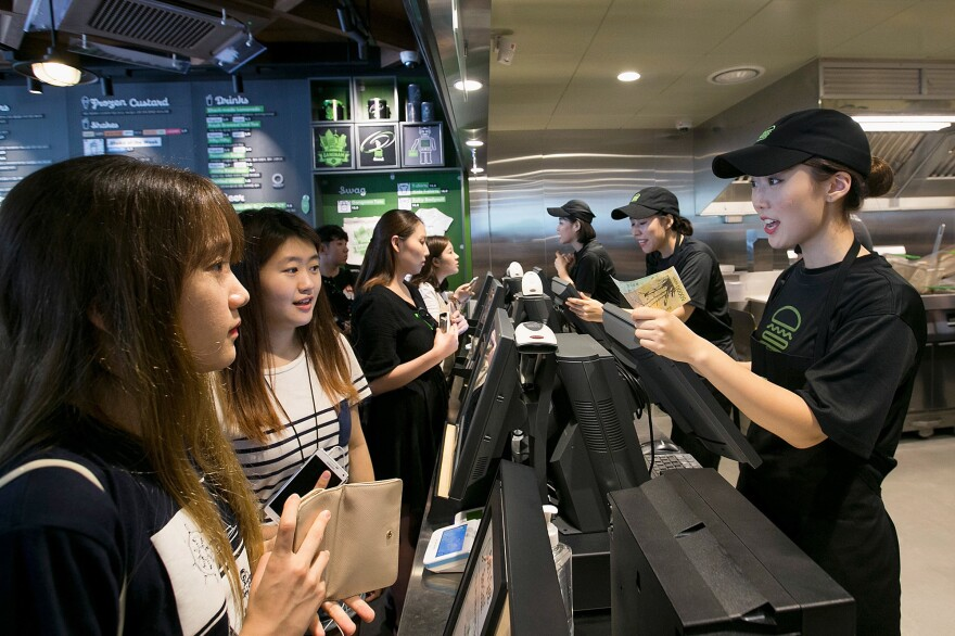 South Korean customers place orders at the July opening for Shake Shack's store in Seoul's hip Gangnam District.