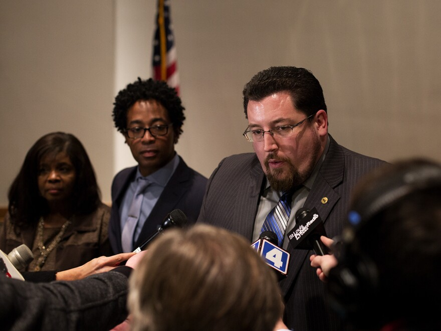 Ferguson Mayor James Knowles III talks to reporters after a 2016 city council hearing. Knowles is seeking a third term leading Ferguson, where a police officer shot and killed 18-year-old Michael Brown in 2014.