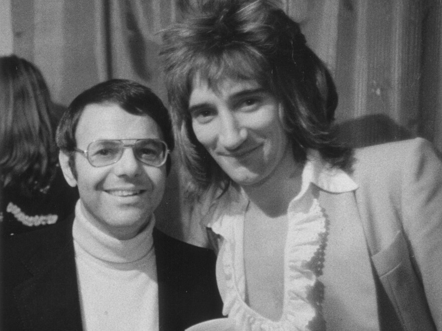 Joe Smith poses with Rod Stewart, circa 1974. The former record executive conducted informal interviews with dozens of musicians in the mid-1980s.