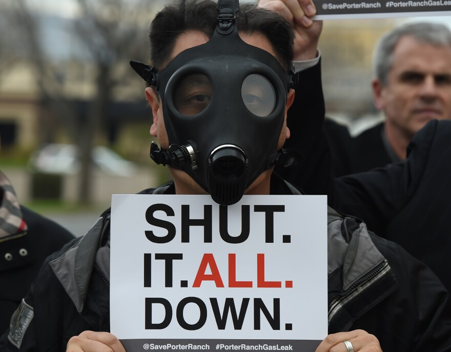 A Porter Ranch resident wears a gas mask during a protest Saturday outside a meeting of the Air Quality Management Board over the Aliso Canyon gas leak. The leak started in October and has forced thousands of residents to flee from the Los Angeles suburb of Porter Ranch. Regulators have ordered the gas company to shut down the leaking well; some residents want the entire facility shuttered.