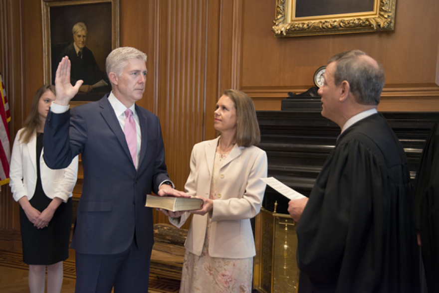 Supreme Court Justice Neil M. Gorsuch takes the judicial oath of office in 2017. Gorsuch may be the deciding vote in a case over whether the Civil Rights Act of 1964 prohibits discrimination based on sexual orientation and gender identity.