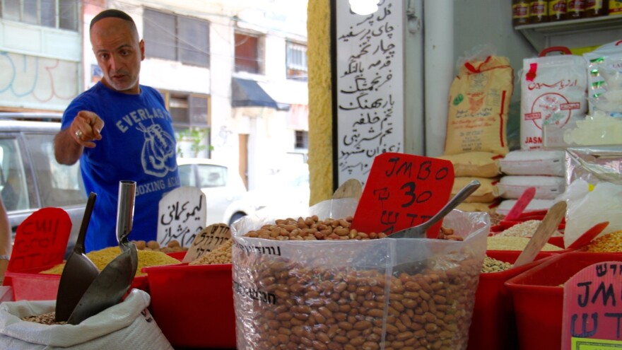Behruz Baradarian sells spices, nuts and Iranian specialties in his shop in Tel Aviv's Levinsky Market.