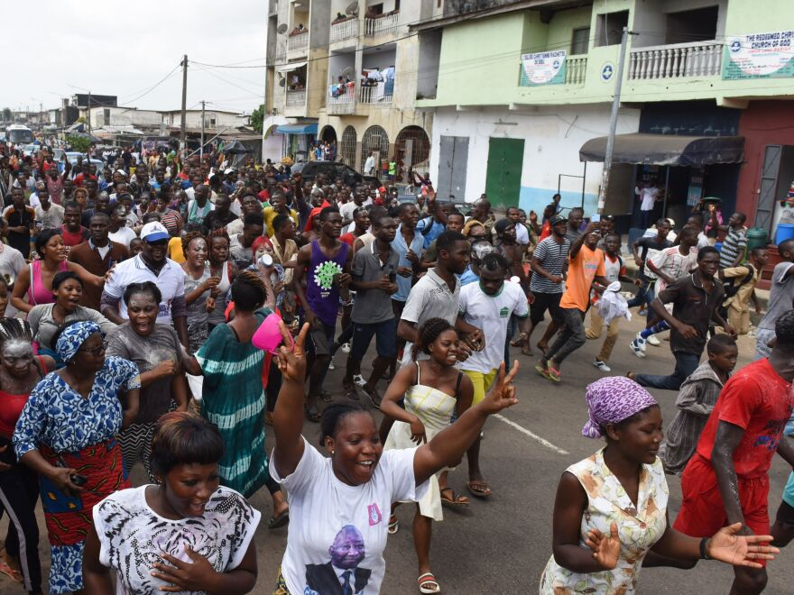 People celebrate the ruling on the streets in the Abidjan district of Yopougon on Tuesday.