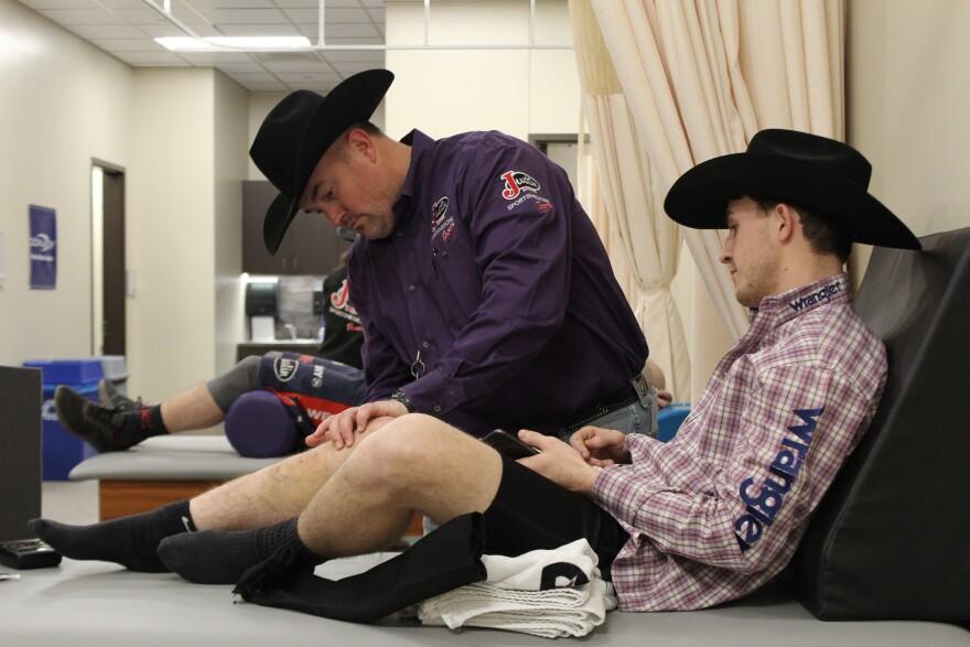 Dr. Jason Mogonye and bull rider Trey Kimzey.
