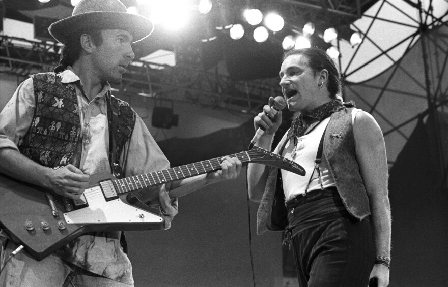 """The Edge and Bono perform in the Netherlands during U2's The Joshua Tree tour in 1987. The U2 song """"I Still Haven't Found What I'm Looking For,"""" inspired by gospel, has become a rock and roll hymn, even finding its way into real-life church services."""