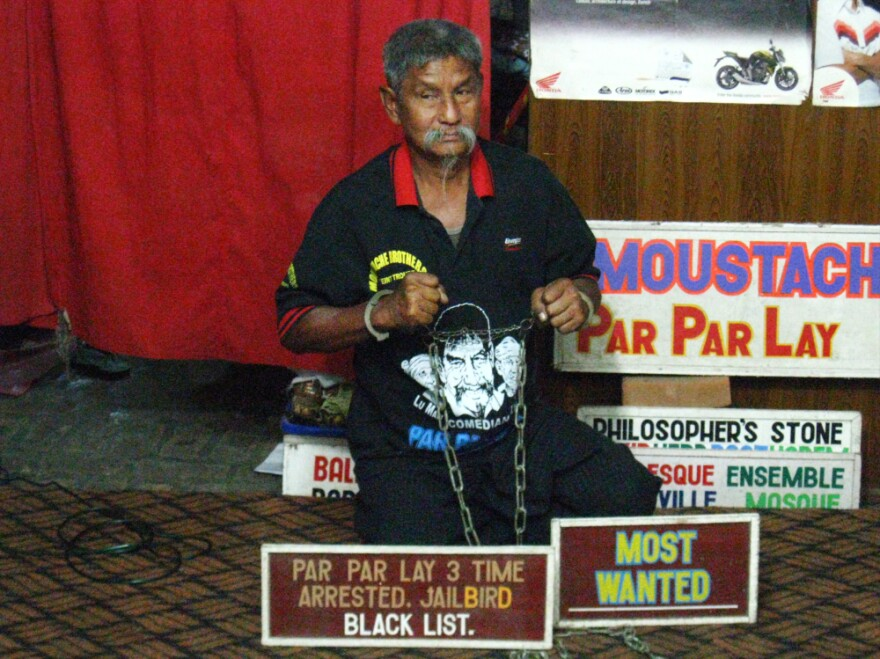 Par Par Lay, a member of the Moustache Brothers vaudeville troupe whose show includes biting political satire, performs recently in Mandalay, in northern Myanmar. Par Par Lay, who had been imprisoned, says he is not yet convinced the reforms are real.