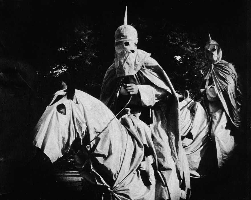 In a still from <em>The Birth of a Nation</em>, two actors dressed in the full regalia of the Ku Klux Klan ride at night. The racist movie, directed by D.W. Griffith, was one of the first feature-length blockbusters in U.S. history. It inspired protests by African-Americans — and gave one man the idea for a response in the same format.
