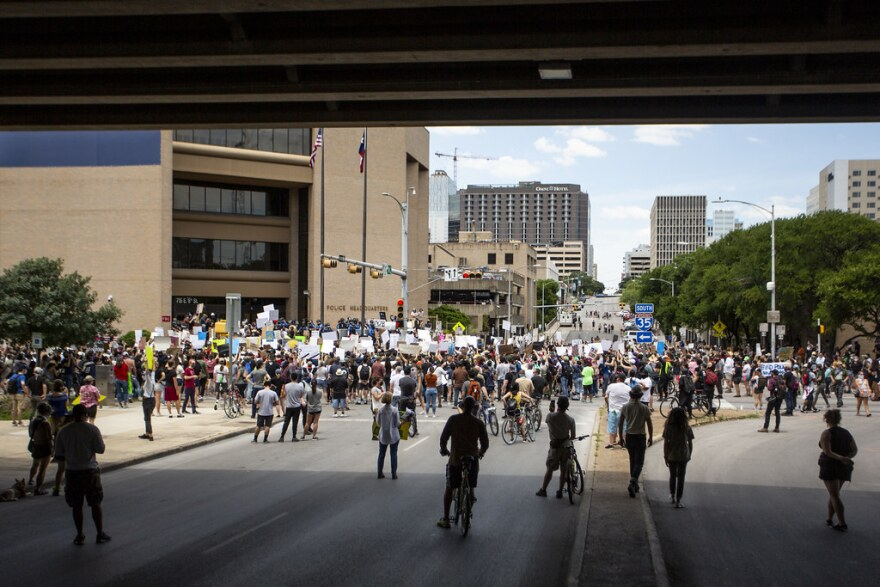Hundreds protest outside of Austin Police headquarters Saturday afternoon. The front doors were boarded up before the protest started.