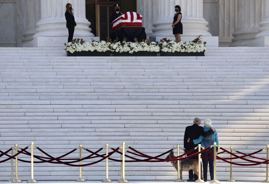 People pay respects to Ruth Bader Ginsburg.