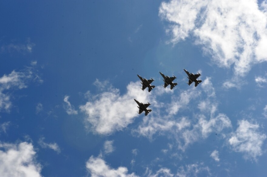 Photo of military airplanes flying in a v formation.