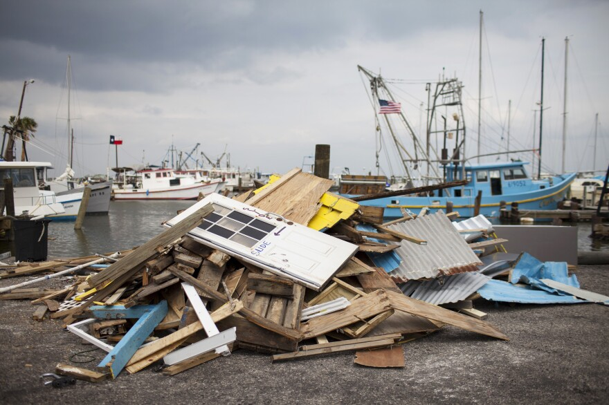 Debris outside of Long Nguyen's Fulton Harbor Bait Stand. With storm damage to the docks,  Nguyen says it's too dangerous to take out his shrimp boat.