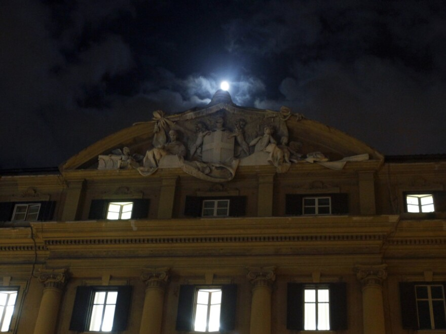 The moon rose above Italy's finance and economy ministry in Rome on Monday.