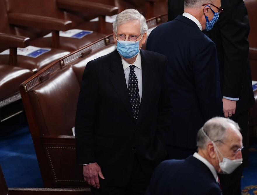 Senate Majority Leader Mitch McConnell arrives Wednesday for the Electoral College vote certification for President-elect Joe Biden, during a joint session of Congress.