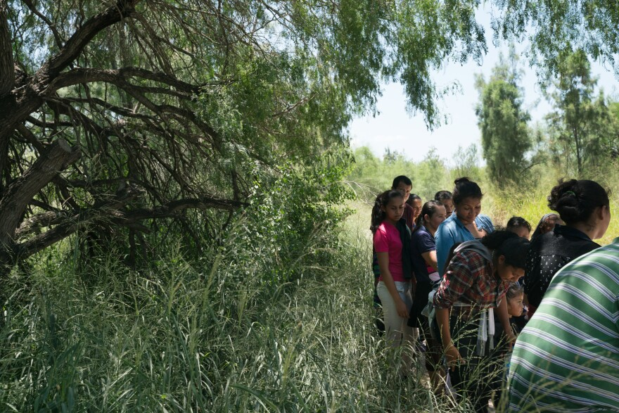 Some 25 people seeking asylum in the U.S. turn themselves in to Customs and Border Protection near McAllen on July 30.