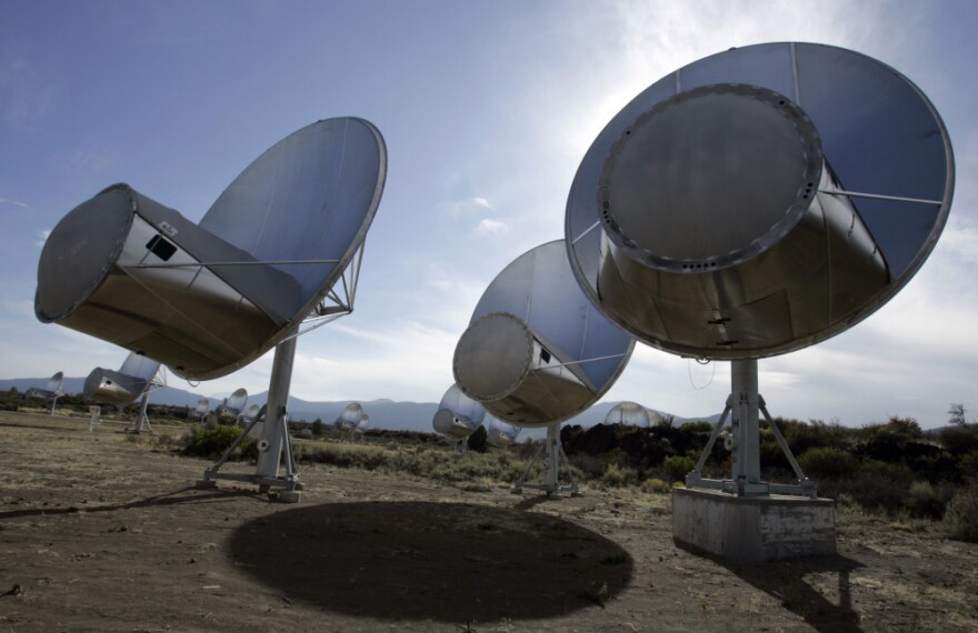Radio telescopes of the Allen Telescope Array are seen in Hat Creek, Calif. A signal that intrigued scientists has been found to have its roots on Earth, Russian scientists say.