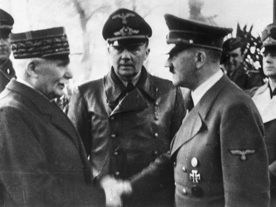 German Chancellor Adolf Hitler shakes hands with Head of State of Vichy France Marshall Philippe Pétain in occupied France on Oct. 24, 1940.