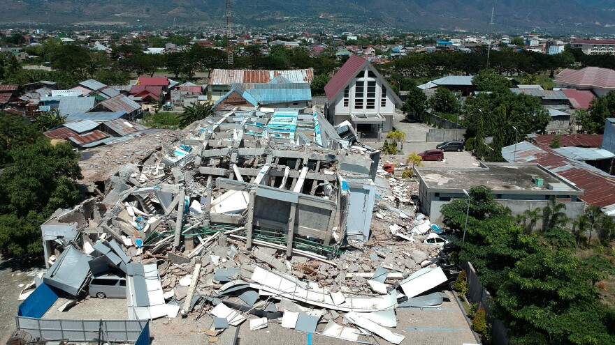This aerial picture shows the remains of a 10-story hotel in Palu in Indonesia's Central Sulawesi on Sunday.