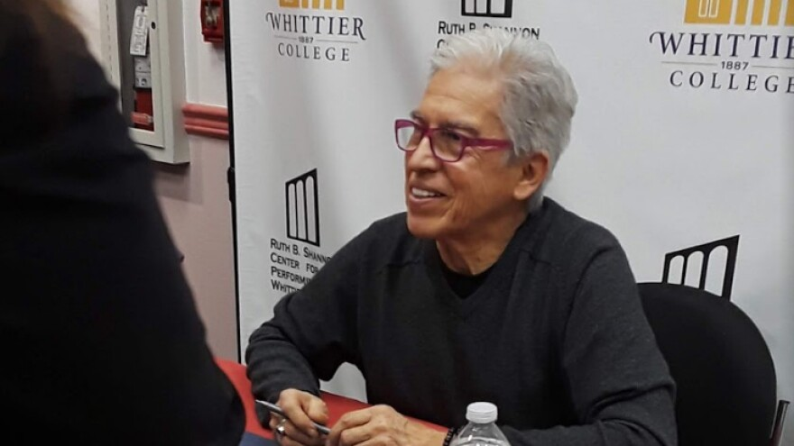 Louie Peréz at a book signing for <em>Good Morning, Aztlán: The Words, Pictures and Songs of Louie Pérez.</em>