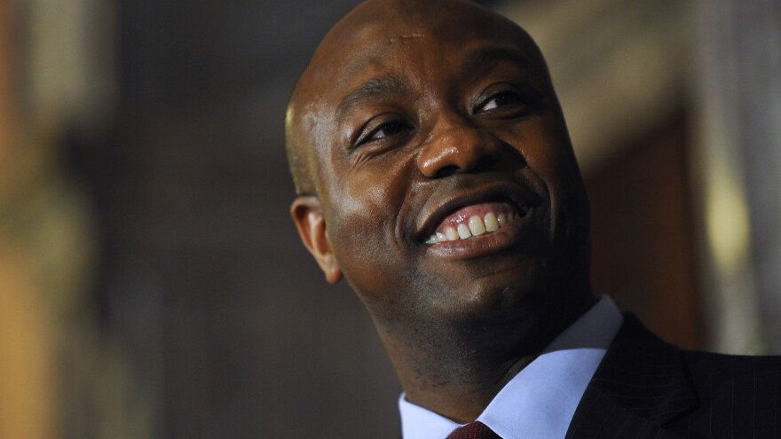 U.S. Rep. Tim Scott smiles during a news conference announcing him as Jim DeMint's replacement in the U.S. Senate at the South Carolina Statehouse on Monday in Columbia.