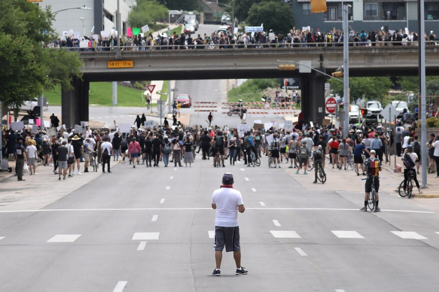 Demonstrators protesting police brutality marched onto I-35 from Austin Police headquarters on Saturday.
