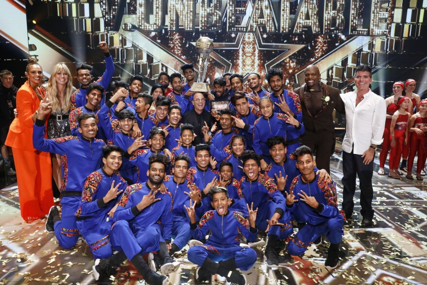 V Unbeatable, the dance troup from Mumbia that won the top prize on <em>America's Got Talent: The Champions</em> this year, are pictured with (left to right) Alesha Dixon, Heidi Klum, Howie Mandel, Terry Crews and Simon Cowell.