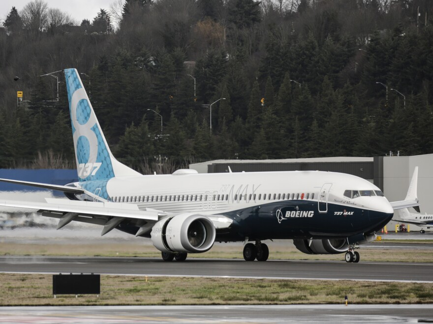 A Boeing 737 Max 8 airliner lands at Boeing Field to complete its first flight on Jan. 29, 2016, in Seattle. The Boeing 737 Max is the fastest-selling plane in the company's history.