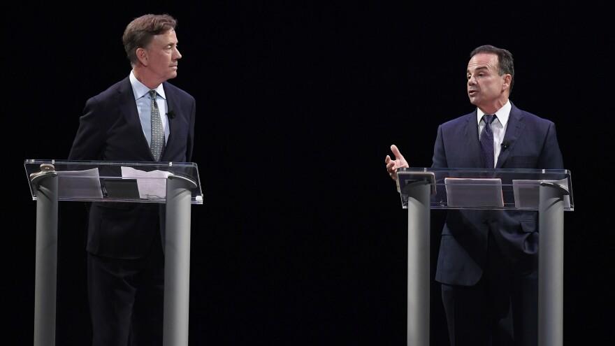 Democratic candidates for governor Ned Lamont and Bridgeport Mayor Joe Ganim debate in New Haven, Conn., last month.