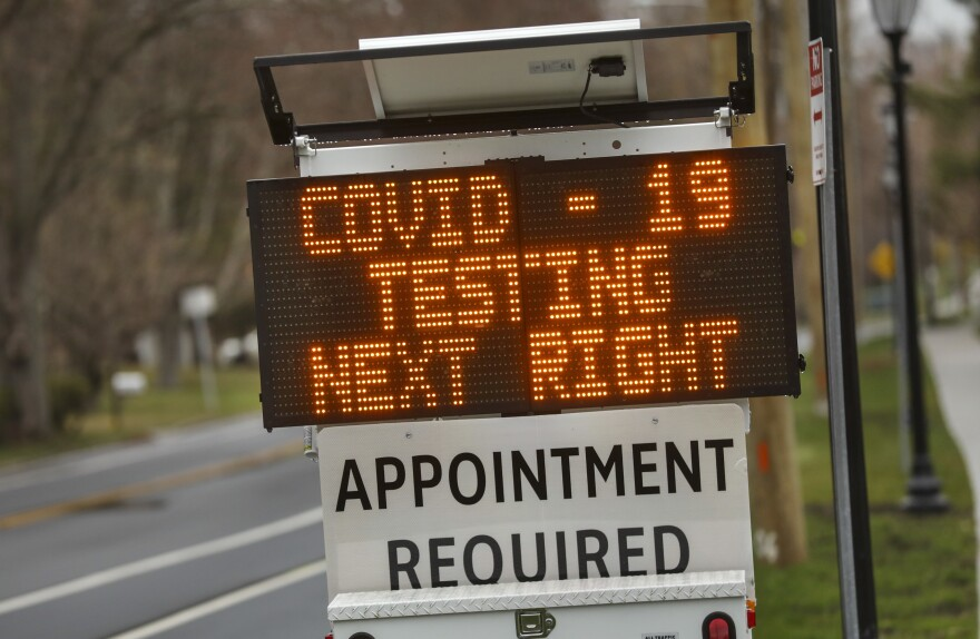 A digital sign on March 28 directs patients to the drive-through coronavirus test site at Stony Brook University in New York.