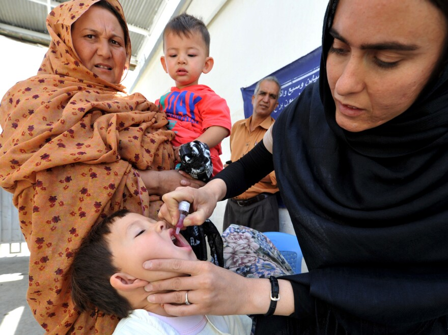 A young girl receives a polio vaccine at the Isteqlal hospital in Kabul on Sept.19, 2011.