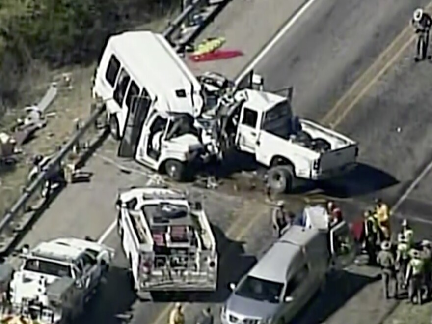 In this aerial image taken from video footage Wednesday, authorities respond to a deadly crash involving a pickup truck and a bus filled with church members on U.S. 83 outside Garner State Park in northern Uvalde County, Texas.
