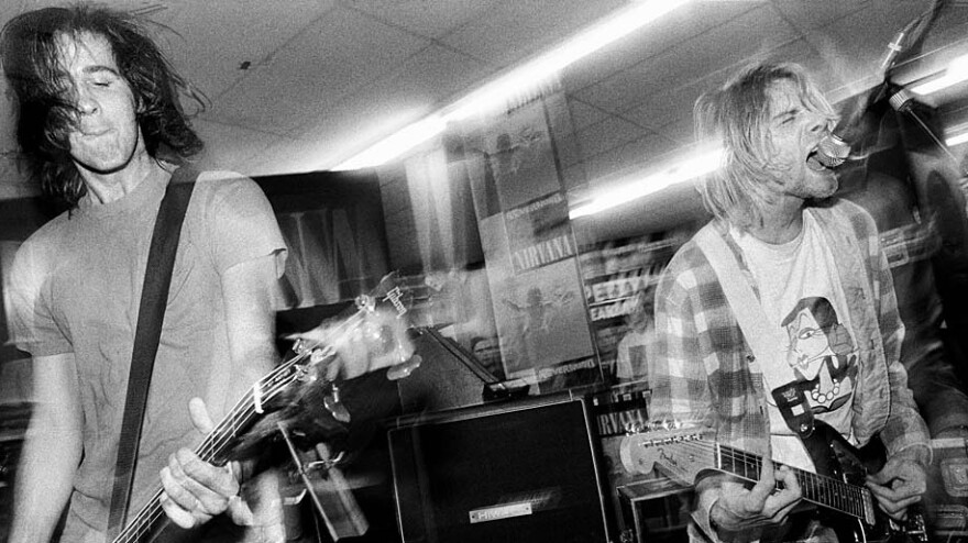 Krist Novoselic and Kurt Cobain play <em></em>at Beehive Records in Seattle  to celebrate the release of <em>Nevermind </em>in September 1991.