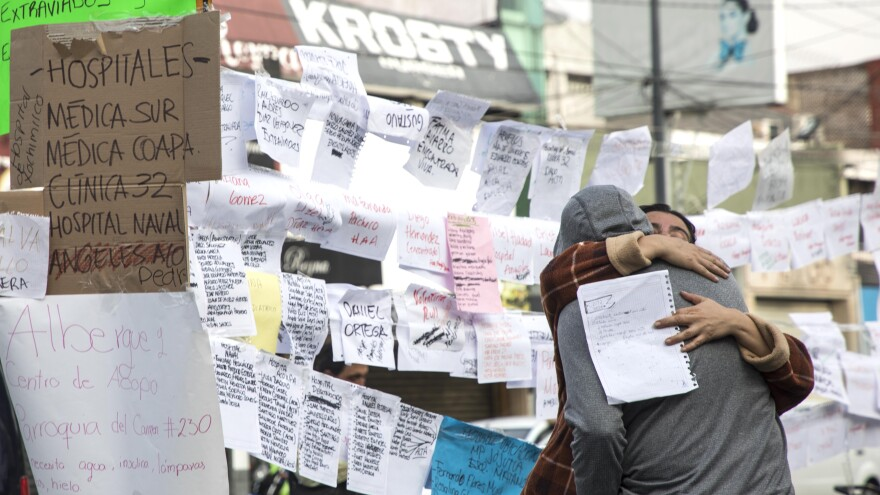 Lists of names crowd a wall in Mexico City, detailing who has been saved and who remained missing Wednesday.