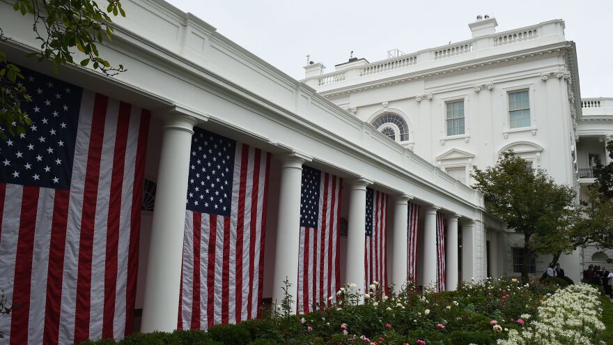 The Rose Garden of the White House is decorated in U.S. flags before President Trump announces his Supreme Court nominee on Saturday.