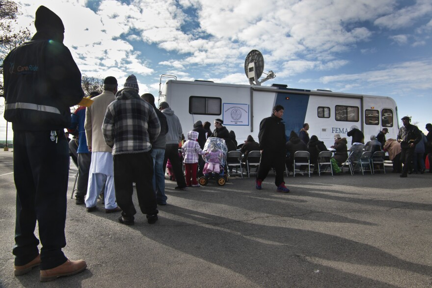 Victims of Superstorm Sandy wait in line to apply for recovery assistance at a FEMA processing center Friday on New York's Coney Island. The agency has been praised for its response to the storm.