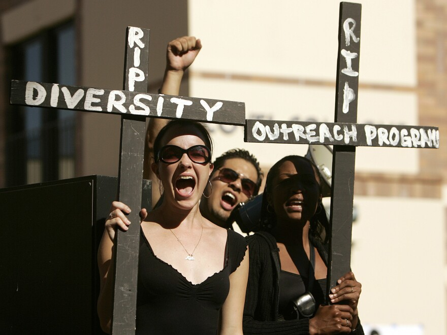 UCLA students hold crosses, while taking part in a 2006 rally on campus to express their concerns about the lack of racial diversity in the student body.