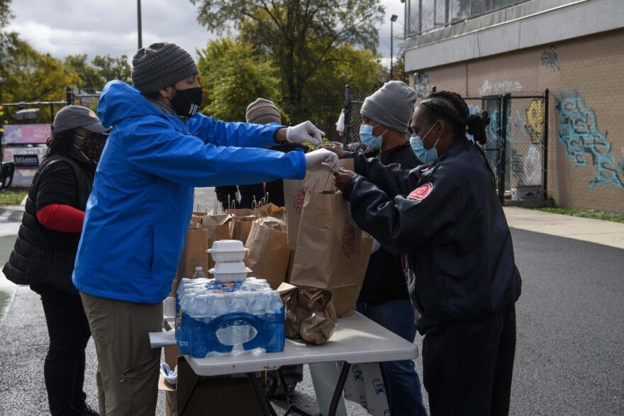 Members World Central Kitchen distribute food to voters and poll workers at a polling station in Washington, DC during early voting.