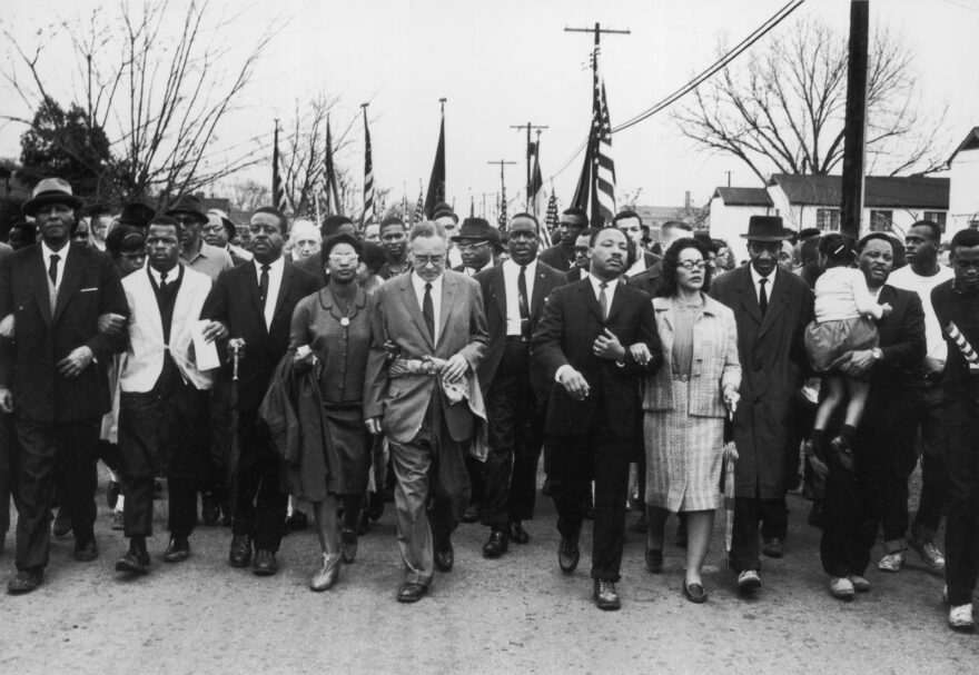 Martin Luther King and his wife Coretta Scott King lead a black voting rights march from Selma, Alabama, to the state capital in Montgomery. Among those pictured is the late civil rights activist and Congressman John Lewis, who died earlier this year.