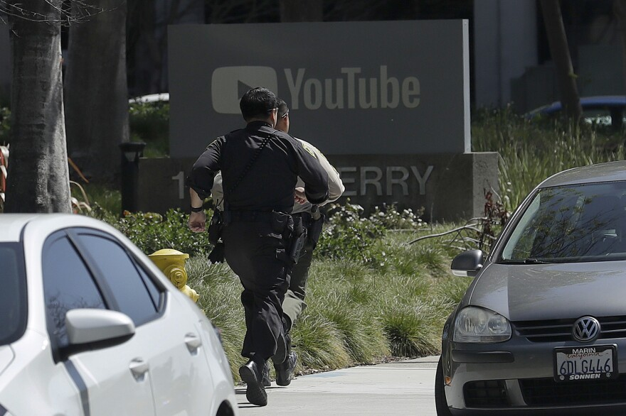 Officers respond to a shooting at YouTube headquarters in San Bruno, Calif., on Tuesday. The suspect wounded several people before reportedly kiling herself.