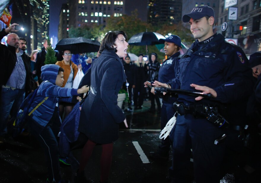 Erin Michelle Threlfall argues with NYPD officers at a protest against President-elect Donald Trump in New York City on Wednesday.