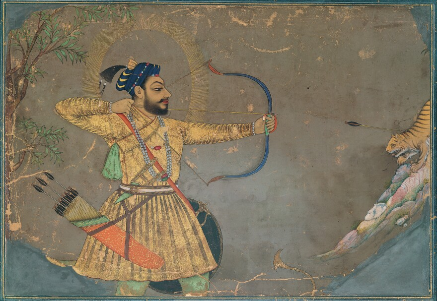 """Traditionally, India's miniature paintings told stories of heroism, lovers and political intrigue through gilded works of art. <em>Sultan 'Ali 'Adil Shah II Slays a Tiger</em> (ca. 1660) is part of that tradition. <strong><a href=""""http://media.npr.org/assets/img/2015/10/02/66.-sultan-ali-adil-shah-ii-slays-a-tiger-300_archive.jpg"""" target=""""_blank"""">Click here to enlarge.</a></strong>"""