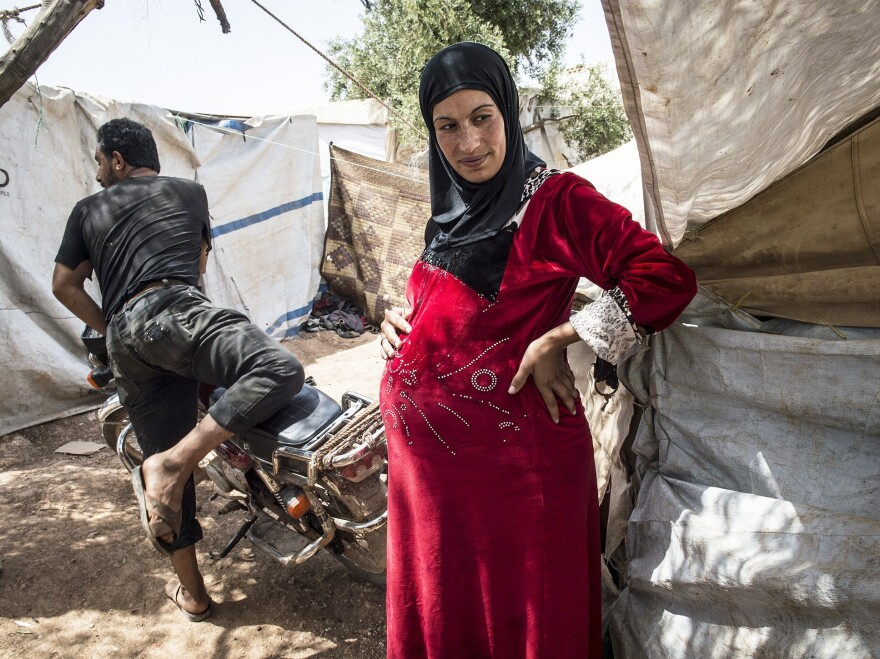 A pregnant woman at the Atmeh refugee camp in Idlib, Syria.