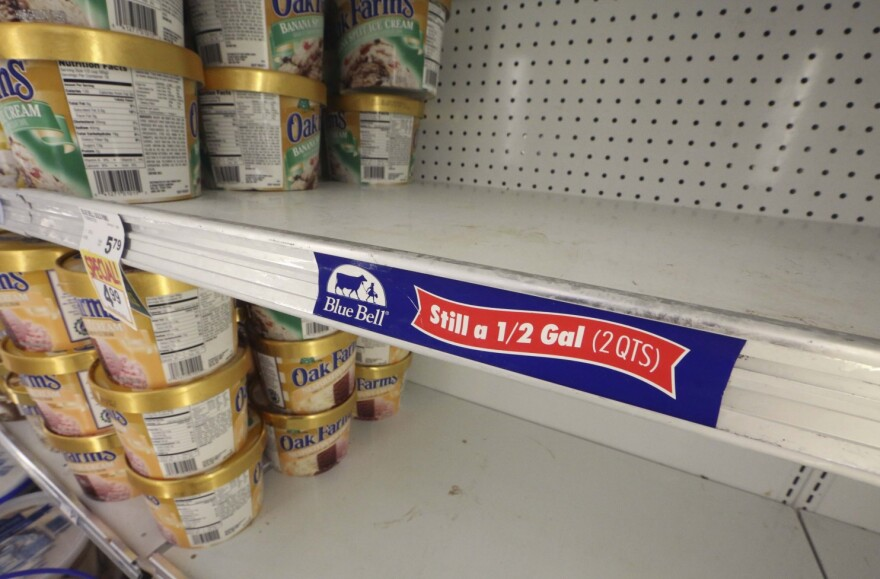 In this April 21, 2015 file photo, shelves sit empty of Blue Bell ice cream at a grocery store in Dallas after Texas-based Blue Bell Creameries issued a voluntary recall for all of its products.