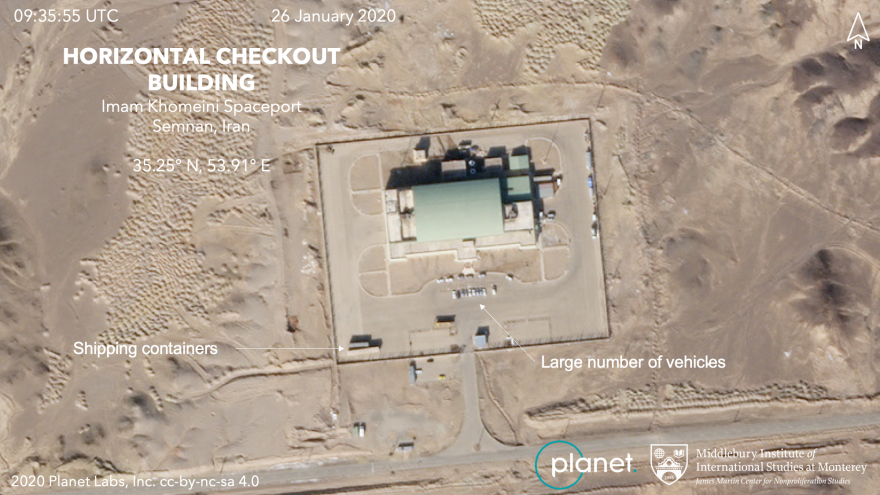 Parked cars are visible near the vehicle assembly building, where Iran's space rockets are put together.